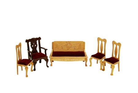 Formal wooden chairs with a bench for comfortable seating  Фото со стока