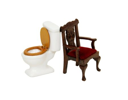 kingly: Porcelain toilet with wooden seat and formal chair both depicting a throne