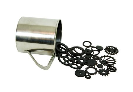 interlink: Various gears with interlinking teeth and cogs pouring from a stainless steel cup for drinking or holding items