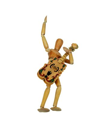 Wooden model representing a person holding a stringed musical instrument and rocking outWooden model representing a person Stock Photo - 4343375