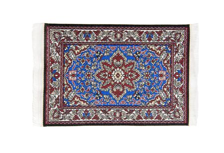 Intricate rug full of bright colors flowers and leaf patterns Stock Photo