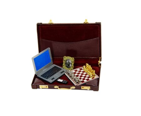 Leather briefcase used to carry items to the office including a laptop, cell phone, photo, and a chess set Stock Photo - 4381164