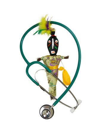 exploratory: Voodoo doll representing an interesting culture of magic and suggestions of luck and destiny intertwined with a stethoscope