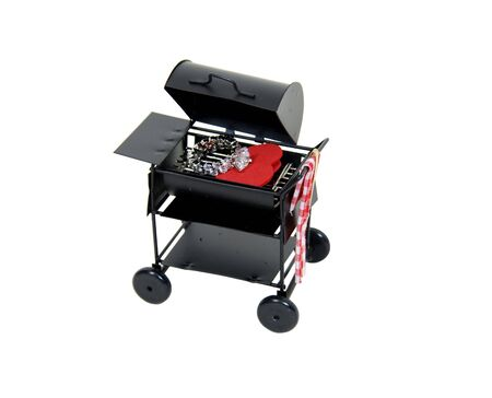 fiance: Metal barbeque grill used for easy weekend get togethers with friends, and a large engagement diamond ring on a red heart