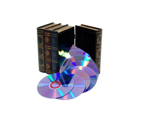Large wooden block hollowed and carved to resemble a book pouring out a group of DVDs giving the impression that both books and computers have abundant information Stock Photo