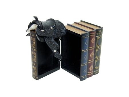 resemble: Large wooden block hollowed and carved to resemble a book and a leather saddle on the side