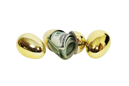 Money in the form of many large bills filling a golden egg --Cut Path Full Size photo