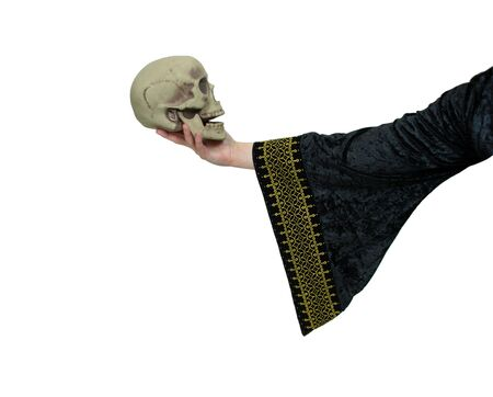Gypsy wearing gothic outfit holding out a skull