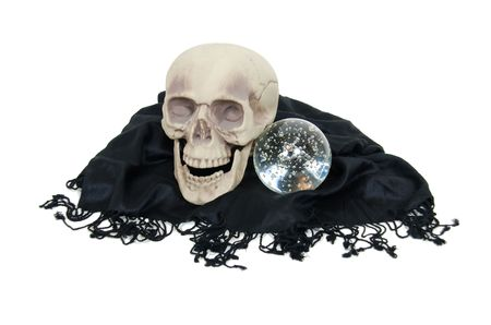 foresee: Crystal ball for seeing into the future with a skull on a delicate black shawl with fringe