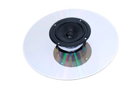 DVD holding several volumes of music with a speaker for enjoyment - Path included Stock Photo - 4631926