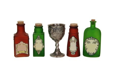 Silver antique chalice with grapes and leaves embossed on the sides and bright colorful potions