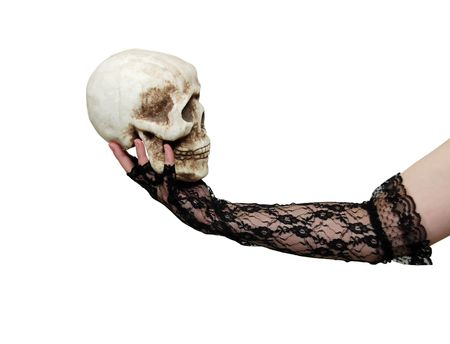 theatrics: Wearing lace gloves with a delicate pattern holding a skull-Path included Stock Photo