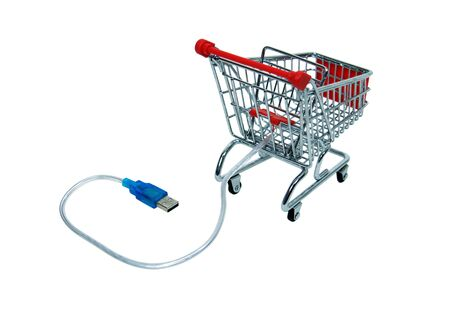 usb various: USB cable used to plug various items into a computer for power, storage, or convenience attached to a shopping cart Stock Photo