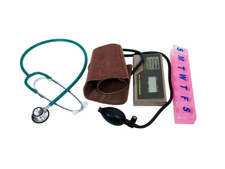 ailment: Blood pressure cuff, stethoscope and daily pill box for home monitoring for health maintenance