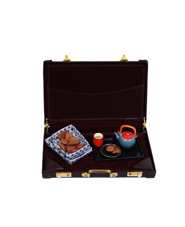 biscuts: Tea biscuts and cookies served with a tea pot and cup in a briefcase - Path included