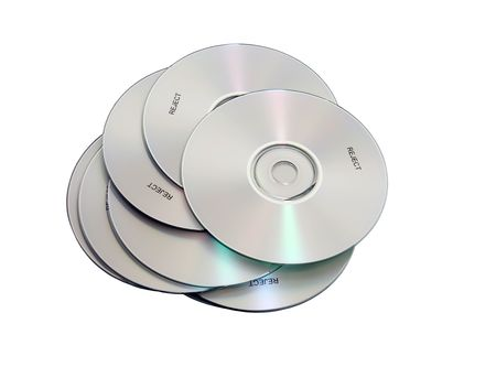 A stack of CDs containing a myriad of information but marked rejected - Path included