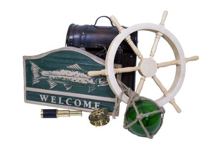 Carved wooden nautical sign with a large fish and the word welcome, ship steering wheel, glass float, old fo - Path included Reklamní fotografie - 4792001