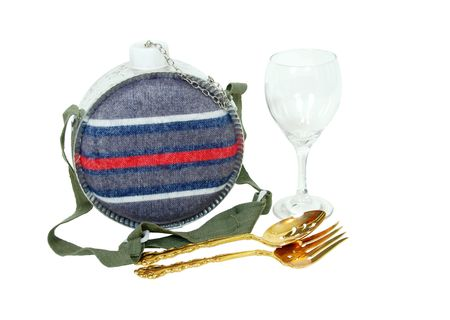 Camping style canteen with carrying strap to keep hydrated while outdoors with goldware and wine glass