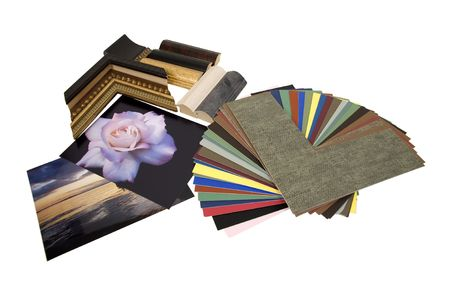 Deciding on a framing project with an assortment of colored matboard and frame samples - path included