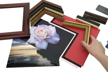Deciding on a framing project with an assortment of colored matboard and frame samples - path included Reklamní fotografie - 4834417