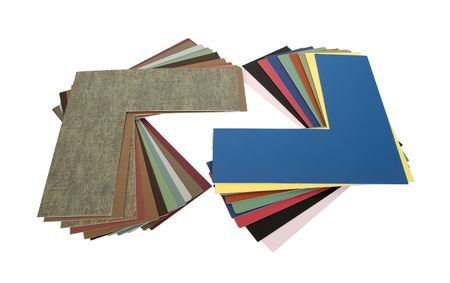 An assortment of colored matboard fanned out to pick colors for framing projects - path included