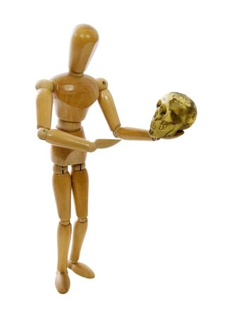 theatrics: Wooden model representing a person holding a skull during a performance - path included Stock Photo