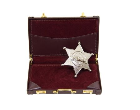 five star: Silver five pointed star used as a sherff badge sitting in a briefcase - included Stock Photo