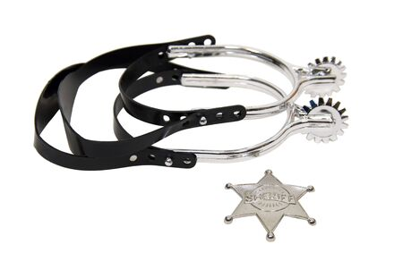 Cowboy spurs and sheriff star in silver and leather