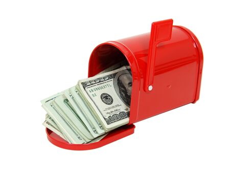 Red metal mailbox with signal flag full of large bills of money Foto de archivo