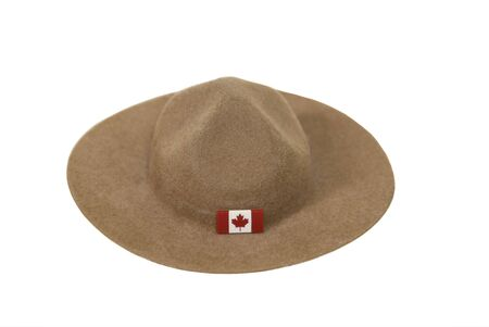 mountie: Canadian Mountie hat made of felt with the traditional folds on the top and a flag on the brim Stock Photo