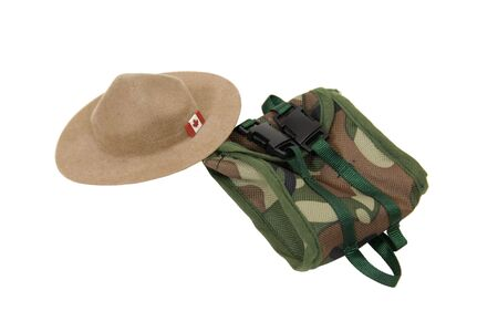 mountie: Canadian Mountie hat made of felt with the traditional folds on the top and a flag on the brim with a backpack