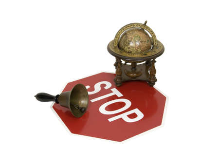 cautionary: Stop sign is a traditional safety and cautionary measure so that everyone shares the road, with an antique globe and school bell