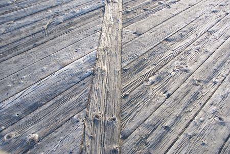 Weatherbeaten wooden walkway laid out in an interesting pattern