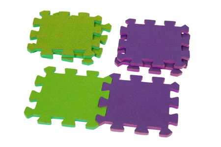 Stacks of contrasting color puzzle pieces interlocked together to make a pleasing pattern - path included