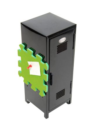 Black metal locker used to store items while participating in extra curricular activities with a cork board with a note held up with a thumb tack - path included Banco de Imagens