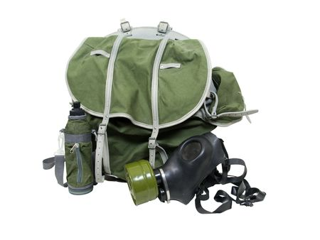 Rubber gas mask to protect the wearer from airborne pollutants and toxic gases, with heavy duty backpack and water bottle photo