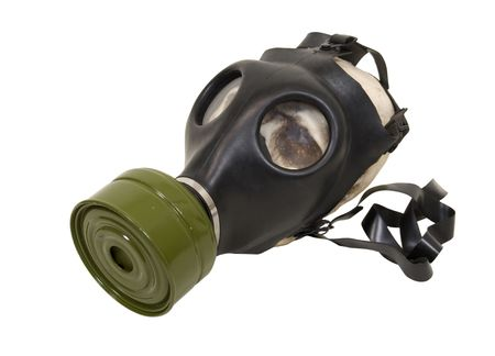 Rubber gas mask to protect the wearer from airborne pollutants and toxic gases - path included Stock Photo - 4948934