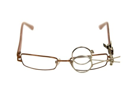 enhance: Clip on lenses that help enhance and magnify items by to a pair of glasses Stock Photo