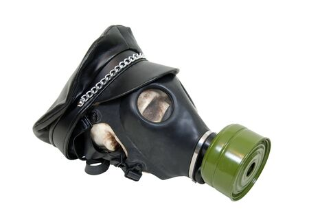 Rubber gas mask to protect the wearer from airborne pollutants and toxic gases worn by a skull with a biker cap with chains - path included