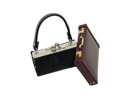Black fabric purse with silver ball clasp used to hold items and a leather briefcase Stock Photo - 4963846