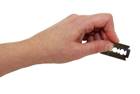 Holding a silver razor blade used for shaving or cutting items Stock fotó