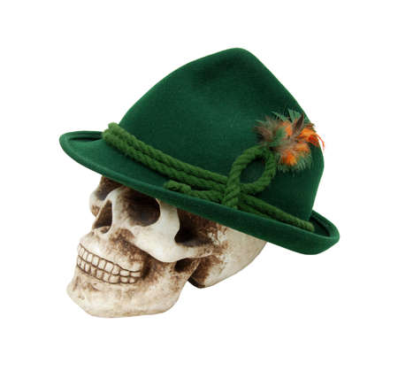 Traditional green felt German alpine hat with rope twists and bright feathers on a skull