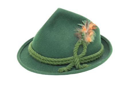 Traditional green felt German alpine hat with rope twists and bright feathers Stockfoto