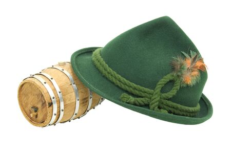 Traditional green felt German alpine hat with rope twists and bright feathers with an oak barrel