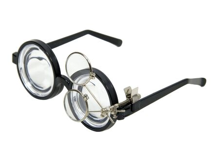 enhancing: Thick lenses on black frames with extra lens clipped on to enhancing focus Stock Photo