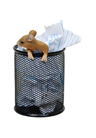 Metal mesh garbage container for rubbish and discarded items with an office mouse Stock Photo