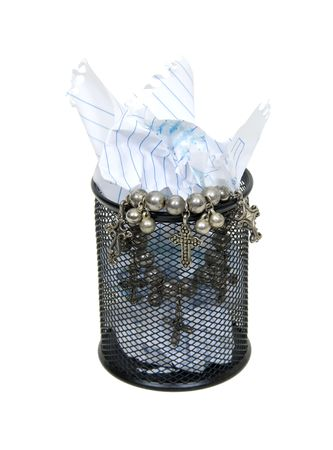 discarded metal: Metal mesh garbage container for rubbish and discarded items holding a silver cross trinket of value Stock Photo