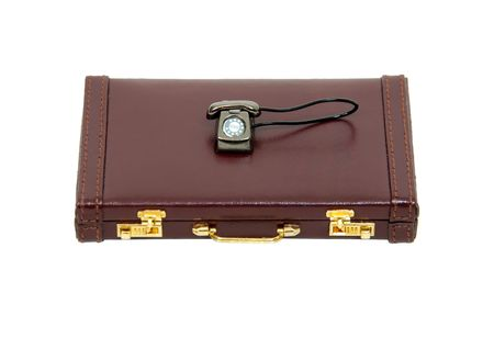 Traditional desk phone with rotary dial on a leather briefcase Stock Photo - 4990614