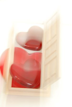 Hearts of love in a dream-like state coming through a wooden interior door to gain entrance to another room