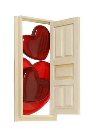 Wooden interior door with five panels used to gain entrance to another room open to several red glass hearts - included